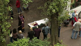 Priest Says a Prayer Over the Dead. DONETSK, UKRAINE- 10 July 2014: Priest Says a Prayer Over the Dead stock video