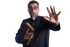 Priest scared shounting raising hand stock photo