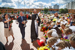 The priest sprinkles the crowd with holy water. Balashikha, Russia. Royalty Free Stock Photography
