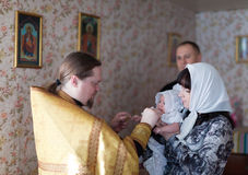 Priest at Sretenskaya church performing christening ceremony Stock Photo