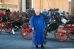 Priest at St. Peters square Royalty Free Stock Photography