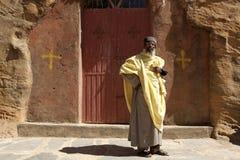 A Priest stood outside a church, Mek'ele Stock Photo