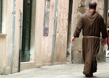 Priest strolling. In the back streets of Venice, Italy Stock Images