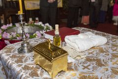 The priest table arrange for a baptism. In a Cristian church royalty free stock image