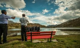 Priest take a picture of nuns in a beautiful place in the alps stock photos