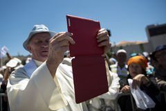 Priest taking a photograph with his mobile phone at the Sanctuary of Fatima during the celebrations of the apparition of the Virgi Royalty Free Stock Photography