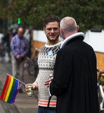 Priest talking to gay man during Gay Pride 2014 in Copenhagen Stock Photos