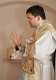 Priest at tridentine mass - benediction stock photography