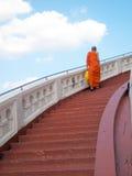 Priest walking up stairs at Wat Saket Royalty Free Stock Images