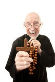 Priest warding off evil Stock Images