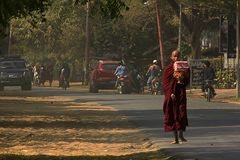 Monks are walking on the street. The priest was walking with bare feet on a side street Royalty Free Stock Photos