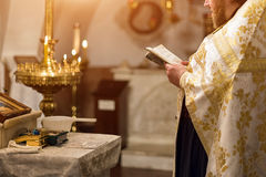 Priest wearing gold robe on ceremony in christian cathedral church, holy sacramental event. Royalty Free Stock Image