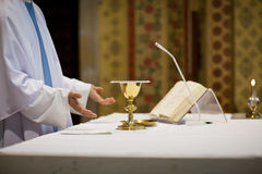 Priest during a wedding ceremony. /nuptial mass stock photography