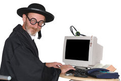Priester op computer Stock Foto's