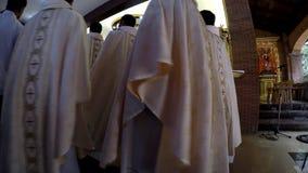 Priestermarsch in der Rezession nach heiliger Masse stock footage