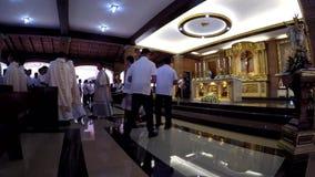 Priestermarsch in der Rezession nach heiliger Masse stock video footage