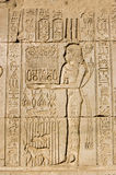 Priestess offering to Goddess Maat. Ancient Egyptian carving on the wall of Dendera Temple of a priestess offering to the goddess Maat Stock Image