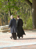 Priests. Two priests are walking in the park Royalty Free Stock Images