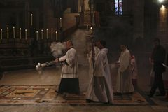Priests at mass in Palma de Mallorca cathedral royalty free stock image