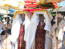 Priests carrying the Tabot during Timket. Priests carrying the Tabot (model of the arc of covenant) of St Michael church during Timket (baptism in Amharic) Royalty Free Stock Photos