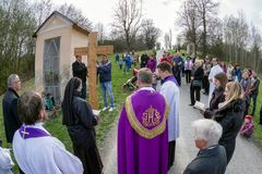 Priests with cross at calvary. RUZOMBEROK, SLOVAKIA - APRIL 14: Nuns with cross at calvary. The Way of the cross during easter on April 14, 2019 in Ruzomberok stock image