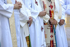 Priests with folded hands. Royalty Free Stock Images