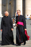 Priests have a conversation during a sunny day stock photo