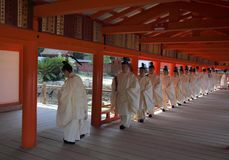 Priests at the Itsukushima shrine on miyajima island japan royalty free stock images