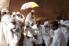 Priests, Lalibela. Priests in a monolithic church in Lalibela stock image