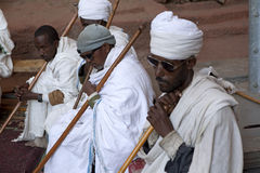 Priests, Lalibela. Priests sat in a monolithic church in Lalibela royalty free stock photo