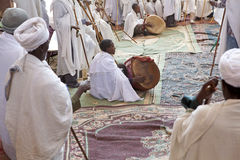 Priests, Lalibela. Priests in service in a monolithic church, two priests have drums. Lalibela stock images