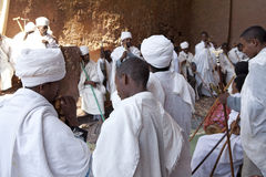Priests, Lalibela. Priests taking prayer in a monolithic church, Lalibela stock photography
