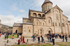 Priests and many other people celebrating the City Day past the Svetitskhoveli Cathedral. UNESCO World Heritage Site. Royalty Free Stock Image