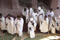Priests in a monolithic church, Lalibela Royalty Free Stock Photo