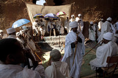 Priests in a monolithic church, Lalibela Stock Photo