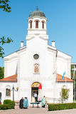 Priests near the Orthodox church in the center of Pomorie, Bulgaria. Pomorie - famous resort town in Bulgaria. In summer it is a popular tourist destination royalty free stock photo