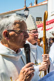 Priests - participants of the procession. Saintes-Maries-de-la-Mer, France - May 25, 2015. Religious feast in honor of the Holy Maries in Provence. The concept Stock Photo