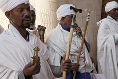 Priests praying, Lalibela. Priests praying, one his talking into a microphone, Lalibela royalty free stock photos