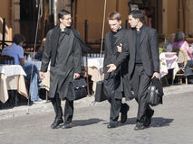 Priests. Rome, Italy - October 30, 2014: Three Catholic priests in Piazza Navona, Rome royalty free stock photos
