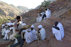 Priests sat on the mountain side, Ethiopia Stock Image