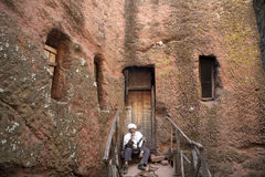 Priests sat outside a church, Lalibela stock image