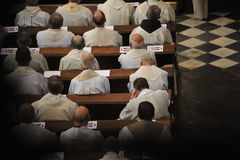 Priests sitting in church. Priests sitting in church, photo taken from the back Stock Photography