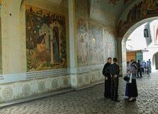 Priests in Trinity Sergius Lavra monastery. Sergiev Posad, Russia - September 1, 2009: Priests in Trinity Sergius Lavra monastery. Popular touristic landmark Royalty Free Stock Photos