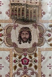 Priests vestment. Decorative symbolic gold needlework on a priests vestment or church cloth royalty free stock photo