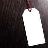 Prijskaartje op houten achtergrond Lege markering kortingen voordeel Het concept van de marketing stock foto's