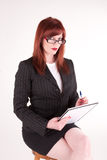 Prim. An attractive older business woman sitting attentively Royalty Free Stock Image