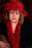 Prim Red Hat Lady Stock Photography