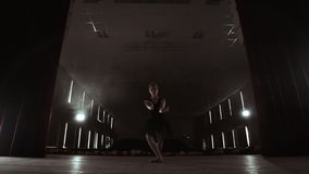 Prima ballet theatre on stage rehearsing performance in the smoke.  stock video footage
