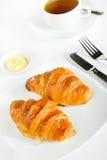 Prima colazione con il croissant ed il tè Fotografia Stock