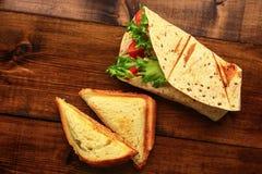 Prima colazione con il panino Immagini Stock Libere da Diritti